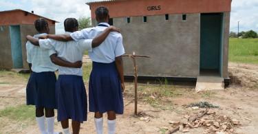 Girls-look-at-their-own-latrine